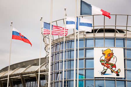 MINSK, BELARUS - MAY 11 - Chizhovka Arena with Volat Mascot on May 11, 2014 in Minsk, Belarus  Flags of Countries Participating in 2014 World Championship IIHF