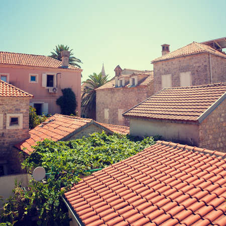 mediterranean house: View of Red Tiled Roofs of Medieval Mediterranean Town. Retro Background.