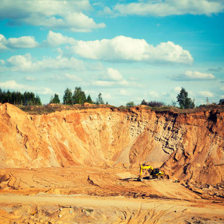 sand quarry: Excavator on a Sand Quarry. Heavy Industry Concept.  Stock Photo