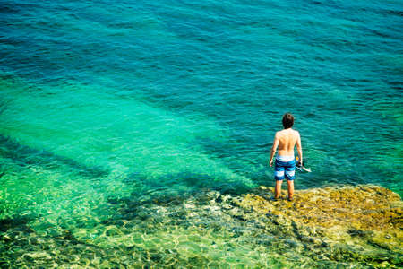 Young Man with Diving Mask Standing in Clear Sea  Healthy Lifestyle Concept  Summer Vacation  Copy Space