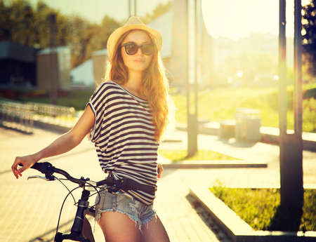 Trendy Hipster Girl with Bike on Urban Background  Toned and Filtered Photo  Modern Youth Lifestyle Concept  Banco de Imagens