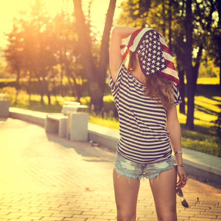 Funny Hipster Girl with USA Flag on her Head.