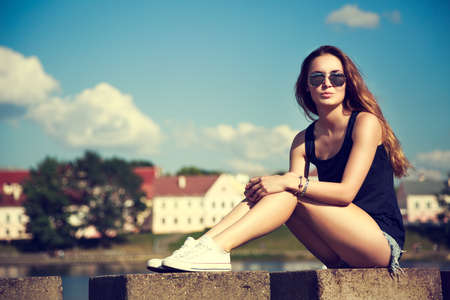 fit girl: Trendy Hipster Girl Relaxing in the Park.   Stock Photo