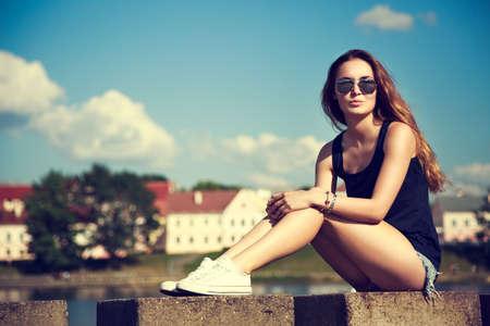 Trendy Hipster Girl Relaxing in the Park.   Stockfoto