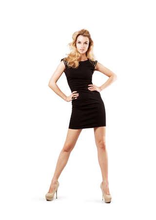 리틀 블랙 패션 드레스에 섹시한 금발 여자의 전체 길이 초상화. 흰색에 격리. 패션과 뷰티 개념입니다. 스톡 콘텐츠