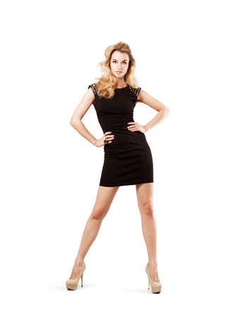 Full Length Portrait of a Sexy Blonde Woman in Little Black Fashion Dress. Isolated on White. Fashion and Beauty Concept.
