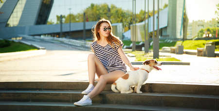 Hipster Fashion Girl with her Dog in the City. Modern Youth Lifestyle Concept. Wide Format Perfect for Website Header or Slider.