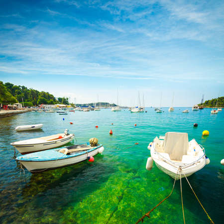 Boat on Crystal Clear Azure Water of Adriatic Sea in Croatia. Mediterranean Travel Concept. Copy Space.