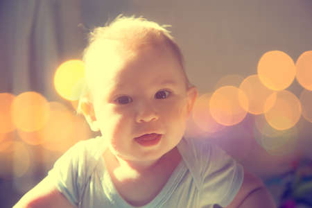 Beautiful Small Baby Portrait. Soft Focus. Toned Photo with Bokeh and Copy Space.