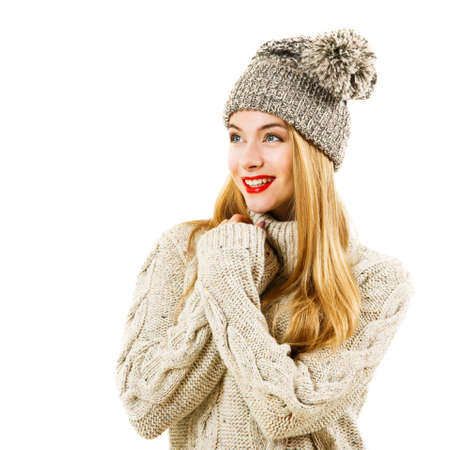 sweater girl: Happy Woman in Knitted Sweater and Beanie Hat Isolated on White. Youth Winter Fashion Concept.