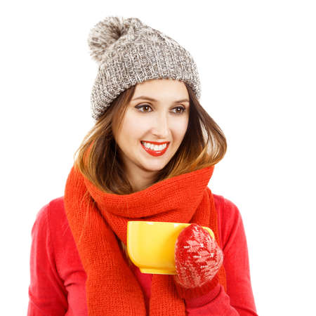 beanie: Pretty Smiling Hipster Girl in Red Sweater, Scarf and Beanie Hat with Cup in Hands. Portrait Isolated on White. Winter Fashion and Warming Up Concept.