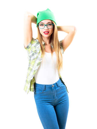 Street Style Hipster Girl in Beanie Hat with Hands behind Her Head Isolated on White. Trendy Casual Teenage Fashion Outfit in Spring or Summer. Stock Photo