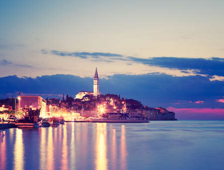 view on sea: Rovinj View at Evening. Medieval Mediterranean Town in Croatia, Europe. Popular Tourist Resort of Istria at Adriatic Sea. Toned Photo with Copy Space.