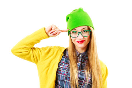 going crazy: Portrait of Funny Street Style Hipster Girl in Glasses Going Crazy Isolated at White Background. Trendy Casual Fashion Outfit in Spring or Autumn. Bright and Vibrant Photo. Stock Photo