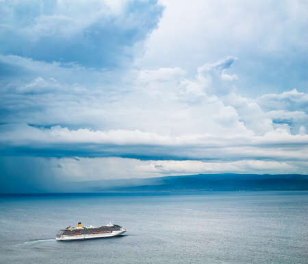 Cruise Ship View. Beautiful Seascape and Dramatic Sky Background. Rain and Stormy Cloudscape. Cold Gray Sea. Cruise Liner Nord Travel Concept. Toned and Filtered Photo with Copy Space. Banco de Imagens