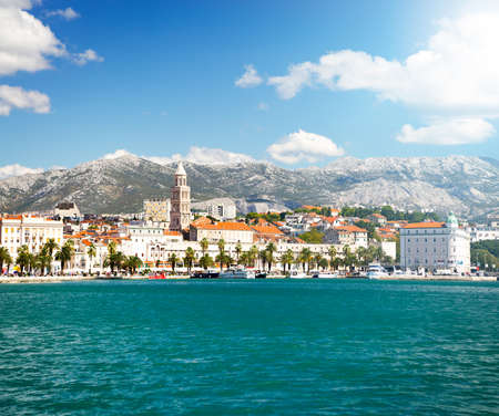 View of Riva and Old Town Split in Dalmatia region, Croatia. Ancient Diocletians Palace on a Sunny Summer Day. Popular Tourist Destination at Adriatic Sea. Mediterranean Europe Travel Concept.