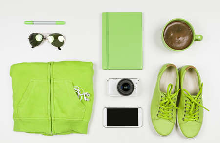 Flat Lay of Modern Green Hipster Accessories. Overhead Top View Photography. Youth Lifestyle Concept. Greenery Color of the Year 2017. Banco de Imagens