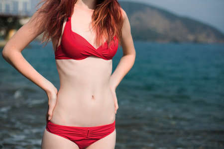 swimsuit: travel body of the girl in a bathing suit near the sea