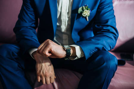 his: Groom looking at his watch expectation wedding Stock Photo