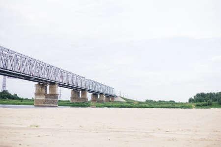 across: railway bridge across the river transport nature
