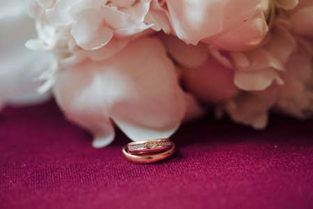 tradition: wedding symbol golden rings background flowers tradition