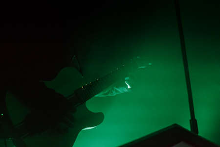 outdoor lighting: Guitarist on stage for background, soft and blur concept