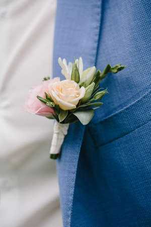 Groom boutonniere on the lapel of his jacket.
