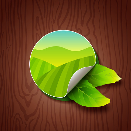tea leaves: Circle Label with Green Fields, Mountains and Two Tea Leaves on Wood Background. Tea Garden on Hills Illustration. Colorful Sticker for Packaging, Logo and Web Design. Illustration
