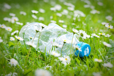 recycle logo: Plastic bottle on grass with recycle logo