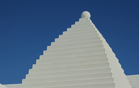 buttery: A typical White Bermuda Buttery Roof, against a deep blue sky Stock Photo