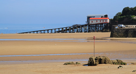 lifeboat station: A wide beach, on a summers day, with a lifeboat station slip, leading into the sea, in Tenby