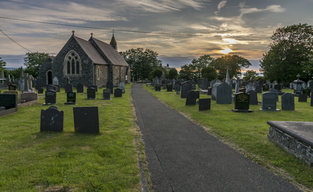 country church: Path leading towards a UK country church at sunset