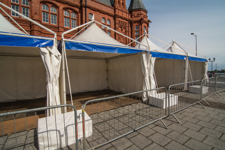 in readiness: A row of static display tents, in readiness for a public event Stock Photo