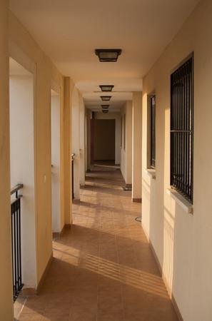 suns: Spanish Apartment Hallway, suns rays slanting across the floor