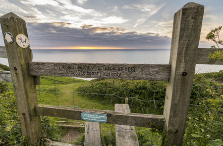 allowing: Wooden stile allowing access the a coastal walking path in Wales Stock Photo