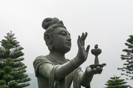 Buddhistic statue making offerings to the Tian Tan Buddha in Hong Kong