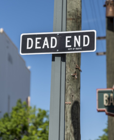 Dead end sign, attached to a wooden post on a city street Stock Photo