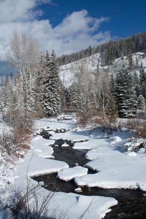 Fresh Snow Fall On Colorado Mountains With Blue Sky Stock Photo