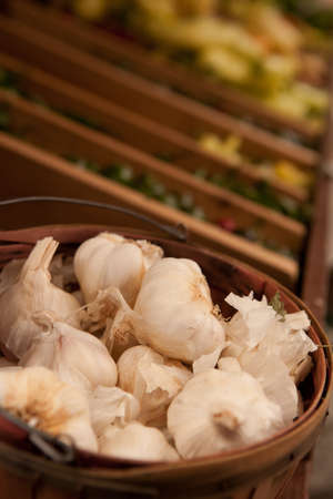 Garlic in a Basket with Vegetable Bins in the Foreground