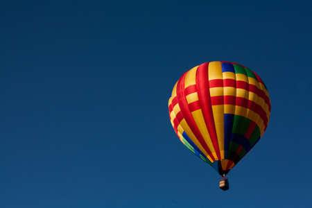 bridget calip: Hot Air Balloon Soars in Perfectly Blue Sky