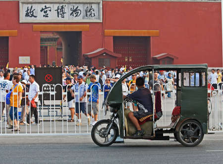 3-wheeled taxi waiting for passenger at Asian tourist attraction