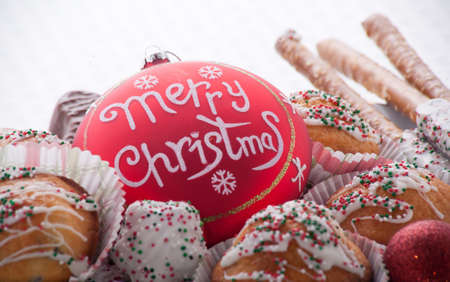 Merry Christmas Ornament With Christmas Goodies photo
