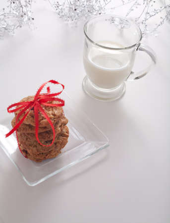 Cookies Tied in a Red Ribbon With Milk and Silver Garland photo
