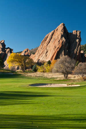 Golf Course With Bunker and Large Red Flat Iron Rocks Stock Photo