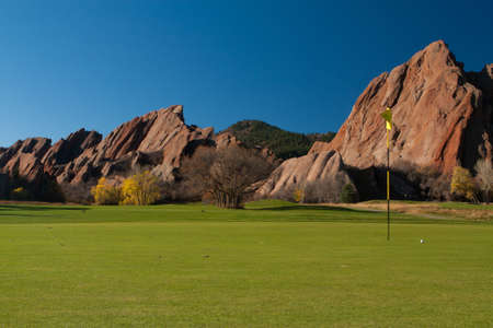 Golf Pin on Mountain Golf Course With Large Red Rocks