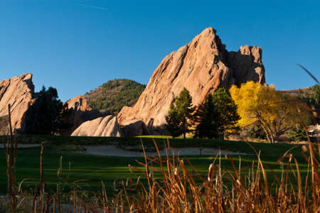 Golf Course With Large Red Rocks In the Autumn Stock Photo