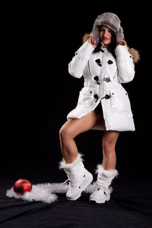 Latina Snow Bunny in White Puffy Coat and Boots photo