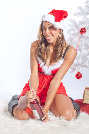 santa lingerie: African American Woman in Sexy Santa Lingerie Opening Wine