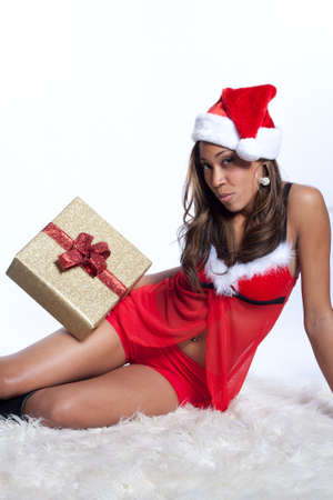 African American Woman in Sexy Santa Lingerie Giving a Christmas Gift