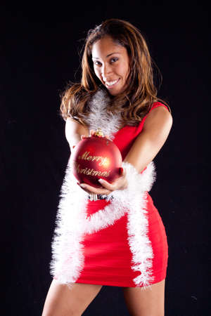 African American Woman in Red Dress With White Garland and Merry Christmas Ornament
